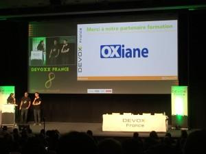 Le logo OXiane en plein écran dans le keynote d'intro de Devoxx France 2015